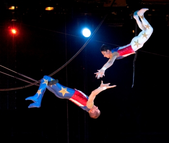 trapeze artists in air